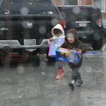 California sloshes through epic rain, snows