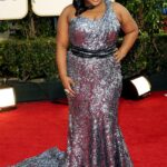 Filipino designer Oliver Tolentino dresses 'Best Dressed' nominee Amber Riley at the Golden Globes