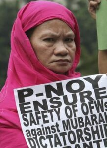 A Filipino Muslim woman displays a message as they picket the Foreign Affairs office in Manila Monday Jan. 31, 2011 to urge the Philippine Government to ensure the safety of Filipinos in Egypt, known as OFWs (Overseas Filipino Workers), following days of protests against the 30-year-rule of Egyptian President Hosni Mubarak. Officials said more than 6,000 Filipinos are working in Egypt and has drawn contingency plans for the possible repatriation of its citizens. (MNS Photo)