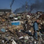 10,000 feared dead in Japan disasters