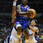 New Orleans Hornets drives to basket in exhibition game against top players of the Philippines
