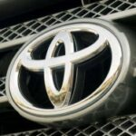 Toyota raises forecasts despite profit slump