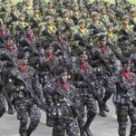 Members of the Special Forces march during the 76th Armed Forces of the Philippines (AFP) anniversary inside the military headquarters of Camp Aguinaldo in Quezon city, metro Manila December 21, 2011. (MNS photo)