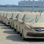 Flood damaged cars sit at the Honda factory in Ayutthaya province on December 27, 2011. ©AFP PHOTO/PORNCHAI KITTIWONGSAKUL