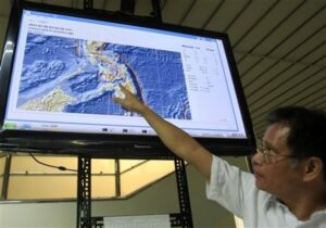 Bartolome Bautista, deputy director of Philippine Institute of Volcanology and Seismology (PHIVOLCS), points to the epicenter of the magnitude 6.8 earthquake which hit central Philippines on Monday Feb. 6, 2012 during a news conference at suburban Quezon city, northeast of Manila, Philippines. Officials said the quake in central Philippines killed at least five people as it destroyed buildings, triggered landslides that buried dozens of houses, trapping residents and listed 29 more as missing. (MNS photo)