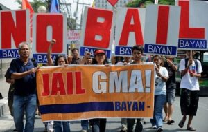 Activists protest in front of the Pasay City regional trial court in Manila on June 21, 2012, against former Philippine president Gloria Macapagal Arroyo's attempt to be granted bail by the high court. Arroyo was arrested in November 2011 after nearly 10 years in power and now awaiting trial on two separates charges of vote rigging and corruption. (MNS photo)