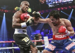 Manny Pacquiao lands a body punch on Timothy Bradley Jr.  during their title fight at the MGM Grand Garden Arena in Las Vegas June 9, 2012. Pacquiao seemed to have won the fight but lost via a controversial split decision. Pacquiao said he wants a rematch. (MNS Photo)