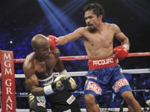 Manny Pacquiao, right, from the Philippines, connects with a right to the head of Timothy Bradley, from Palm Springs, Calif. , in their WBO world welterweight title fight Saturday, June 9, 2012, in Las Vegas. Despite what many believed was a fight won by Pacquaio resulted in a split-decision loss to Bradley. (MNS photo)