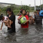 Aquino vows permanent solution to floods