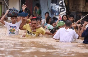 Residents hang on to a rope as they pass strong currents along a flooded area in Marikina, east of Manila, Philippines on Thursday Aug. 9, 2012. A fresh deluge forced more evacuations along fast-rising rivers in the Philippine capital Thursday, as the city and surrounding areas struggled to deal with widespread flooding triggered by nearly two weeks of relentless rains. (MNS photo)