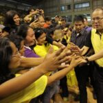 President Benigno S. Aquino III shakes hands with the residents of Dipolog City during his visit at the Andres Bonifacio College (ABC) Gymnasium in Barangay Miputak, Dipolog City, Zamboanga del Norte on Tuesday (February 05). (MNS photo)