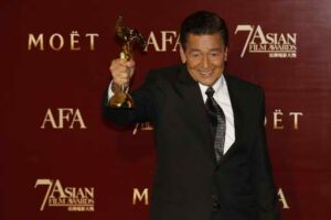"Actor Eddie Garcia of the Philippines poses with his trophy after winning the Best Actor award for his role in the film ""Bwakaw"", at the Asian Film Awards in Hong Kong March 18,2013. (MNS photo)"