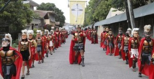 "Penitents, locally known as ""Morions"", wear masks and Roman centurion costumes as they take part in a procession commemorating the passion of Christ during Holy Week at Mogpog town in Marinduque, central Philippines, March 25, 2013. (MNS photo)"