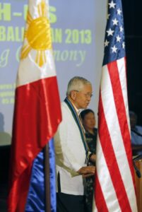 "Philippines Foreign Secretary Albert del Rosario speaks between the U.S. and Philippine flags during the opening ceremony of annual Philippines-U.S. military exercise dubbed as ""Balikatan"" (shoulder to shoulder) at Camp Aguinaldo in Quezon city, Metro Manila April 5, 2013. (MNS photo)"