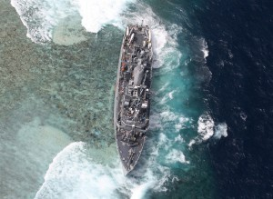 BROKEN COMPASS?: Stuck after running aground the Tubbataha Reef in the Philippines is this USN Navy ship USS Guardian. The Philippines demands that the U.S. pays them P58 million in cash. (MNS Photo)
