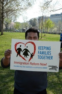 A man with a placard that calls for family reunification at a rally in Washington D.C. last April 11 before U.S. senators unveiled an immigration reform bill that may allow deportees to be reunited with their families. . (Photo from Reform Immigration for America Facebook page)