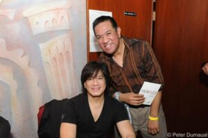 Lead singer Joey Generoso of Side A with line producer of show V Entertainment Vic Perez.