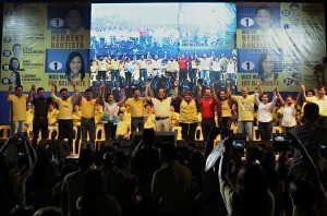 "President Benigno S. Aquino III raises the hands of Team PNoy during the Miting de Avance of the Liberal Party (LP) – Quezon City Chapter at the Amoranto Sports Complex in Barangay Paligsahan, Quezon City on Friday (May 10, 2013). Team PNoy includes Aurora Lone District Representative Juan Edgardo ""Sonny"" Angara, former National Youth Commission (NYC) chairperson Paolo Benigno ""Bam"" Aquino IV, former Akbayan Partylist Representative Ana Theresia ""Risa"" Hontiveros-Baraquel, Senators Alan Peter ""Compañero"" Cayetano and Francis Joseph ""Chiz"" Escudero, former Movie and Television Review and Classification Board (MTRCB) chairperson Mary Grace Poe-Llamanzares, Senator Loren Legarda, former Senators Maria Ana Consuelo ""Jamby"" Madrigal and Ramon Magsaysay, Jr., Senators Aquilino Martin ""Koko"" Pimentel III and Antonio ""Sonny"" Trillanes IV, and former Las Piñas Representative Cynthia Villar. (MNS photo)"
