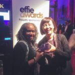 "AT&T's Jennifer Jones and interTrend's Julia Huang accepted the Effie award for ""Away We Happened."""