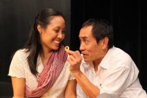 Bonna Tek (Arun) and Jo Jo Gonzales (Vichear Lam) share a happy moment. Photo by Amy Davis.