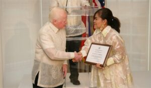 Ambassador Jose L. Cuisia Jr. congratulates White House Executive Chef Cristeta Comerford after she was presented with an award of recognition for her accomplishments during the Independence Day Reception at the Hay Adams Hotel in Washington, D.C. (Philippine Embassy Photo by Elmer G. Cato)