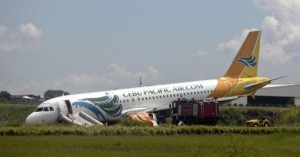 A Cebu Pacific Air Airbus A320-200 passenger jet is seen with its nose touching a grassy area at Davao International airport in southern Philippines June 3, 2013, after it overshot a runway on Sunday evening. Local media reported that the airport was shut down on Sunday night after the Cebu Pacific Air flight from Manila overshot and veered on the right side of a runway. All of the 165 passengers were unhurt.  (MNS photo)
