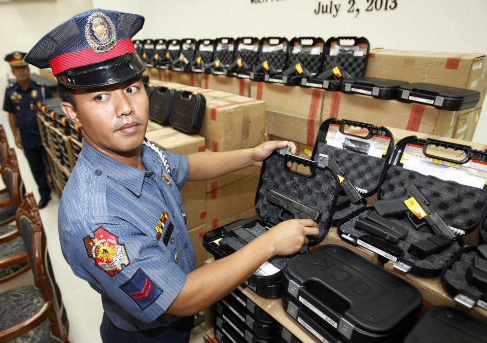 of the pistols at the police headquarters in Manila July 2, 2013