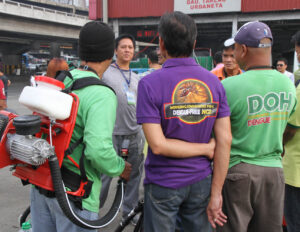The Department of Health-National Capital Region (DOH-NCR) together with the Metro Manila Development Authority (MMDA) conduct joint anti-dengue spraying, disinfection and clean-up of the JAC Liner bus terminal along Epifanio delos Santos Avenue (EDSA) in Quezon City on Friday morning (July 12, 2013). (MNS photo)