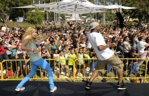 "(l-r) Allison Holker and Stephen ""tWitch"" Boss warm up the crowd with dance moves. Thousands danced together for National Dance Day at downtown Los Angeles' Grand Park, home to the West coast's flagship celebration.  Park visitors joined ""So You Think You Can Dance's"" Nigel Lythgoe, Adam Shankman, Napoleon and Tabitha Dumo and other popular dance celebrities as part of a nationwide grassroots initiative that promotes the joy and benefits of dance for everyone. 7/27/2013Los Angeles California, photos courtesy The Music Center"