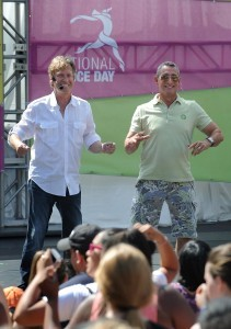 "(l-r) Nigel Lythgoe and Adam Shankman practice choreography with the crowd. Thousands danced together for National Dance Day at downtown Los Angeles' Grand Park, home to the West coast's flagship celebration.  Park visitors joined ""So You Think You Can Dance's"" Nigel Lythgoe, Adam Shankman, Napoleon and Tabitha Dumo and other popular dance celebrities as part of a nationwide grassroots initiative that promotes the joy and benefits of dance for everyone. 7/27/2013Los Angeles California, photos courtesy The Music Center"