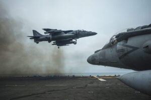 Vertical Landing: An AV-8B harrier jet performs a vertical landing on the flight deck of the USS Boxer in the Pacific Ocean, June 14, 2013. The Boxer is conducting amphibious squadron and marine expeditionary unit integrated training. The jet is part of the air combat element of the 13th Marine Expeditionary Unit. The Philippines said it will allow U.S. and Japan access to its bases. U.S. Navy photo by Petty Officer 3rd Class Mark El-Rayes