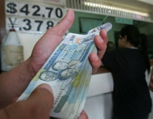 A Man Arranges His Peso Bills Inside Currency Exchange Friday Nov 9