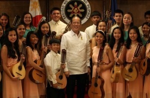President Benigno S. Aquino III poses for a group photo with the Iskwelahang Pilipino Rondalla during the courtesy call held at Malacanang's Heroes Hall. The ensemble formed in 1986 through the vision of Cristina Castro who, with a shoestring budget, searched for several years to find a teacher while building up an arsenal of instruments for the children the IP Rondalla has flourished as a truly Filipino American expression, incorporating into its repertoire aspects of traditional and contemporary music from the Philippines and the United States.also in photo are Violaere Rodriguez Bailey, Education secretary Bro. Armin Luistro and IP Rondalla  founder Cristina Castro (MNS photo)