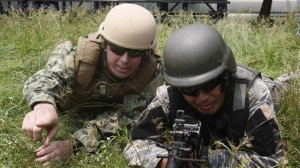 "A U.S. Navy serviceman (left) takes up position with a Philippine Navy serviceman at a live fire exercise during a joint annual military exercise called ""Carat"" at former U.S. military base Sangley Point in Cavite city, west of Manila June 28, 2013. (MNS photo)"