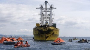 Rescuers search for survivors and bodies near a cargo vessel, which collided with a ferry on Friday, in Talisay, Cebu, August 17, 2013. (photo courtesy of www.voanews.com)