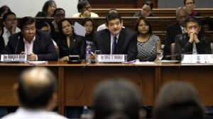 "Senate President Franklin M. Drilon and Senator Francis ""Chiz"" Escudero listen as Senator Teofisto ""TG"" Guingona III, Chair of the Senate Blue Ribbon Committee, question resource persons during the second public hearing on the alleged P10 billion priority development assistance fund (PDAF) scam involving Janet Lim Napoles and certain lawmakers, which were reportedly used in anomalous projects by bogus nongovernment organizations.(MNS photo)"