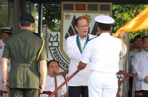 "President Benigno S. Aquino III passes on to newly installed Presidential Security Group (PSG) Commander Navy Captain Raul Ubando the Command Symbol after it was ceded by former PSG Chief B/Gen. Ramon Mateo Dizon during the PSGChange of Command Ceremony and Testimonial Review with Retirement Ceremony at the PSG Grandstand, Malacañang Park in Manila City on Friday (August 30). Ubando is a member of the Philippine Military Academy (PMA) ""Sandiwa"" Class of 1985. PSG is the lead agency tasked in providing security to the President of the Philippines and the First Family. They also provide protective security to visiting Heads of States and diplomats. (MNS photo)."