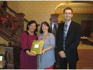 The above photo shows Consul General Ma. Hellen Barber De La Vega presenting a token of  appreciation to Camarillo Chamber of Commerce CEO/Founder Jennifer Wells with Camariilo Chamber of  Commerce, Business Advocacy & Government Affairs Director Sean Paroski.