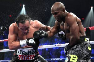Timothy Bradley delivers a right hook to Juan Manuel Marquez's face in this bit of action where Bradley Saturday, October 12 won via split decision. Photo Credit: Chris Farina/Top Rank