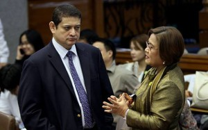 "Blue Ribbon Committee chair, Sen. Teofisto Guingona III and Justice Secretary Leila De Lima reconcile after Guingona earlier admits being ""disappointed"" for not bringing whistle blowers during the pork barrel scam probe at the Senate on Tuesday (Sept. 24, 2013). Both parties shake hands after. (MNS photo)"