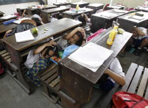 Students hide under school tables and cover their heads with their hands during an earthquake drill at an elementary school in Paranaque city, metro Manila October 17, 2013. The death toll from an earthquake in the Philippines rose to 144 on Wednesday as rescuers dug through the rubble of collapsed buildings including an old church and a hospital. Nearly 3 million people were affected by the 7.2 magnitude quake on October 15.  (MNS photo)