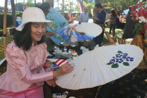 Thai artists show their mastery in umbrella painting during the Thai Food Festival inside Paramount Pictures in Hollywood.