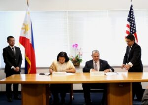 Consul General Maria Hellen M. Barber-De La Vega (left) and Regional Administrator Ruben Rosales, US Department of Labor's Wage and Hour Division, Western Region (right), signing the Cooperative Agreement.