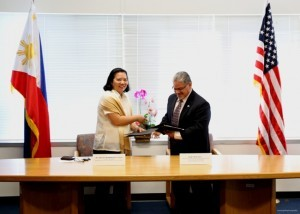 Consul General De La Vega (left) exchanging the Cooperative Agreement with Regional Administrator Rosales.