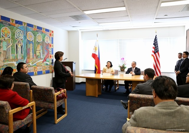 Malou Villacisneros of the Pilipino Workers Center of Southern California addressing Consul General Barber Dela Vega and Regional Administrator Rosales .