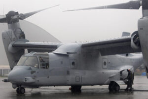 A U.S. Marine refuels a V-22 Osprey, ferrying personnel to help in the relief efforts in Tacloban City, at Villamor Air Base in Manila November 13, 2013. Philippine officials have been overwhelmed by Haiyan, one of the strongest typhoons on record, which tore through the central Philippines on Friday and flattened Tacloban, coastal capital of Leyte province where officials had feared 10,000 people died, many drowning in a tsunami-like wall of seawater.  (MNS photo)