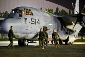 About 80 U.S. Marines arrive on two KC-130J Super Hercules aircraft on Villamor Air Base, Philippines, Nov. 10, 2013. Marine Corps Forces Pacific is working with the Philippine government to rapidly deliver humanitarian assistance and disaster relief in the wake of Typhoon Haiyan. The Marines are assigned to the 3rd Marine Expeditionary Brigade, and the KC-130J aircraft are assigned to Marine Aerial Refueler Transport Squadron 152, Marine Aircraft Group 3. U.S. Marine Corps photo by Capt. Joshua Diddams (U.S. Marine Corps photo by Capt. Joshua Diddams/Released)