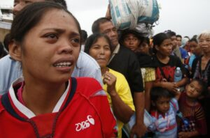 A woman cries after failing to board a military flight by the Philippine Air Force to evacuate typhoon victims in Tacloban city, which was battered by Typhoon Haiyan, in central Philippines November 12, 2013. Rescue workers tried to reach towns and villages in the central Philippines on Tuesday that were cut off by the powerful typhoon, fearing the estimated death toll of 10,000 could jump sharply, as relief efforts intensified with the help of U.S. military. The flight was full and would return to continue the evacuation, according to officials.  (MNS photo)