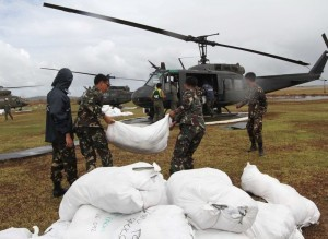 CHOPPER LOADING:Food packs for the victims and other relief goods are loaded into the airforce chopper to be distributed to Santa Fe in Tacloban City, Leyte to the urban area affected by the super typhoon Yolanda, Saturday (November 16). (MNS photo)