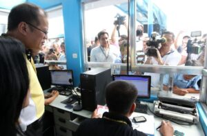 "President Benigno S. Aquino III listens to the briefing on the status of the volume of passengers by SWIPTS terminal manager Dir. Amante Salvador during the inspection on the security arrangements and facilities at the Southwest Integrated Provincial Transport System (SWIPTS) departure area at the Uniwide Coastal Mall in Baclaran, Parañaque City on Thursday (October 31, 2013) to ensure the safety of the passengers for the observance of the All Saints' and All Souls' Day during the Visit to Major Terminals in Metro Manila for DOTC's Undas 2013 ""Oplan Ligtas Biyahe"". (MNS photo)"